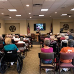 Residents from St. Andrew's Village and Harvard Square engaged in Patti's presentation.